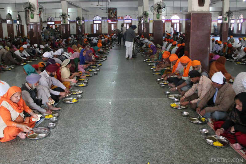 People Sitting At the Floor to have food